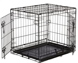 An empty and black double door wire crate with doors wide open
